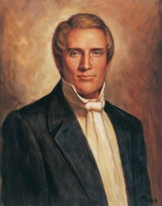 A painting of Hyrum Smith. He wears a black suit coat, white shirt, and white cravat