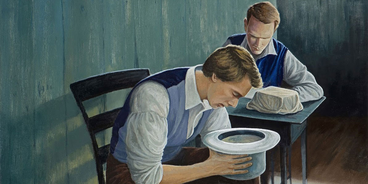 A painting. Joseph Smith sits on a chair in what looks like the upstairs of the Whitmer home, with someone behind him across a table, writing. A bundle covered in cloth, presumably the plates, sits on the table. Joseph looks into a white top hat.